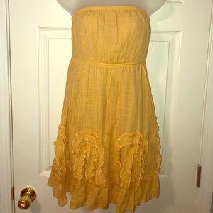 Golden strapless dress with ruffle details